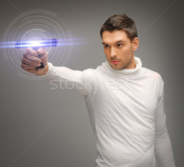man with sci fi weapon Stock photo © dolgachov