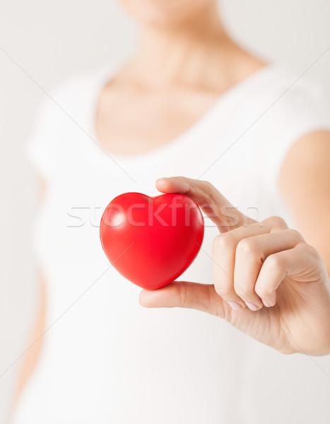 Mulher mãos coração menina amor Foto stock © dolgachov