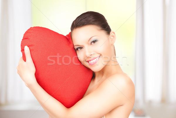 Kobieta czerwony poduszkę domu szczęśliwy model Zdjęcia stock © dolgachov