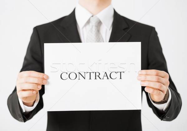 man hands holding contract paper Stock photo © dolgachov