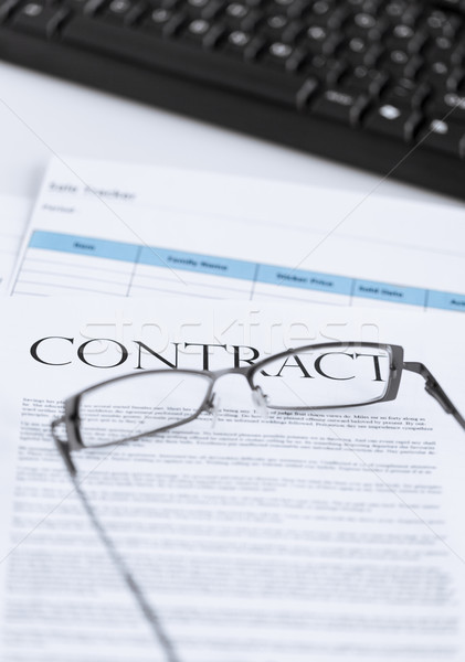 signed contract paper with glasses Stock photo © dolgachov