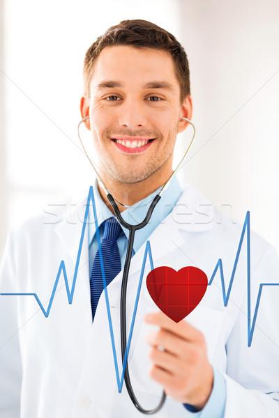 Lekarza słuchania bicie serca stetoskop faktyczny ekranu Zdjęcia stock © dolgachov