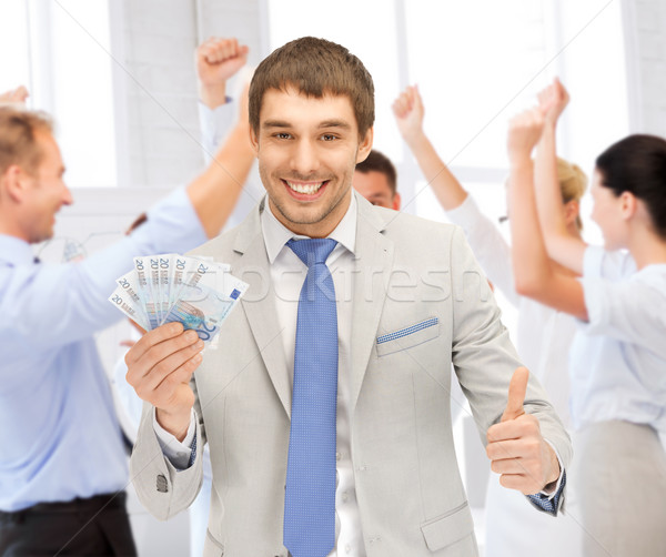 happy businessman with cash money in office Stock photo © dolgachov