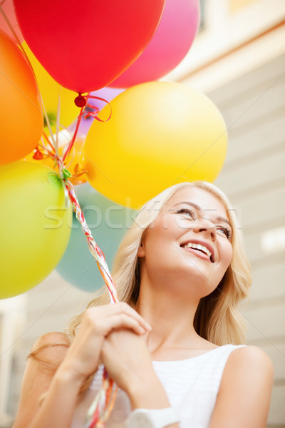 woman with colorful balloons Stock photo © dolgachov