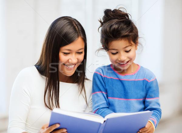 Anya lánygyermek könyv család gyerekek oktatás Stock fotó © dolgachov