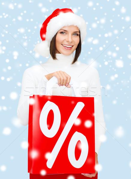 Kadın yardımcı şapka alışveriş Stok fotoğraf © dolgachov
