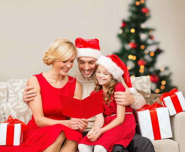 Glimlachend familie lezing briefkaart christmas kerstmis Stockfoto © dolgachov