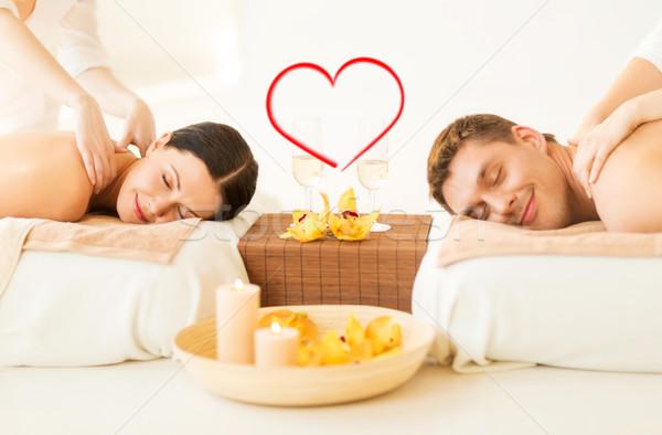 couple getting massage in spa salon Stock photo © dolgachov