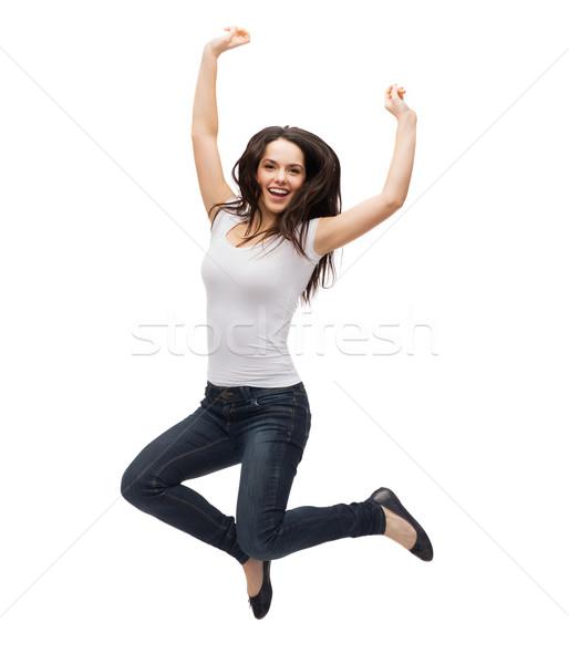 Tienermeisje witte tshirt springen activiteit geluk Stockfoto © dolgachov