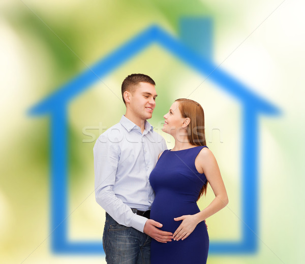 happy young family expecting child Stock photo © dolgachov
