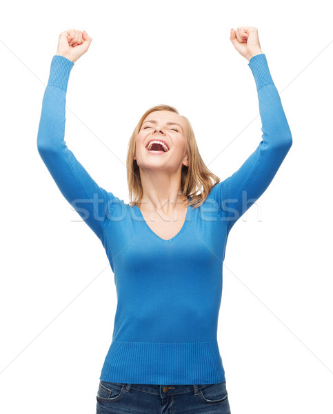 laughing young woman with hands up Stock photo © dolgachov