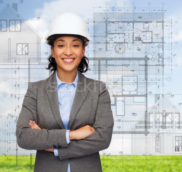 Photo stock: Femme · d'affaires · blanche · casque · bras · bâtiment · développement