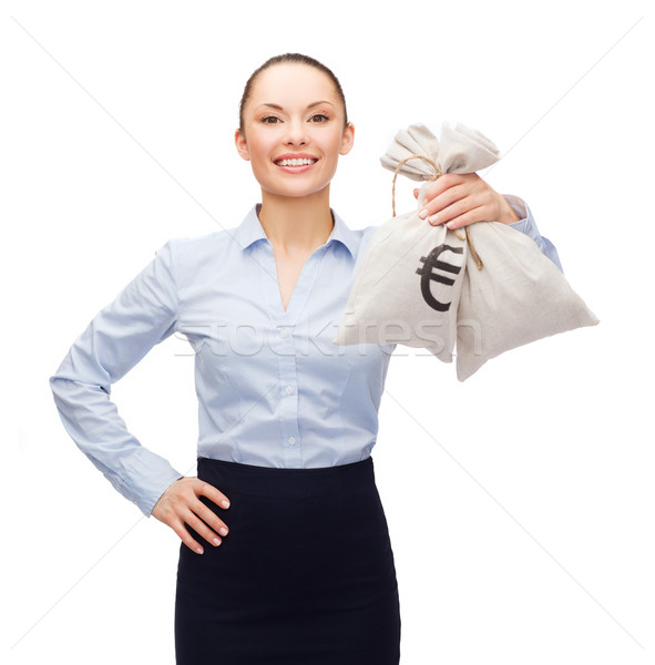 young businesswoman holding money bags with euro Stock photo © dolgachov
