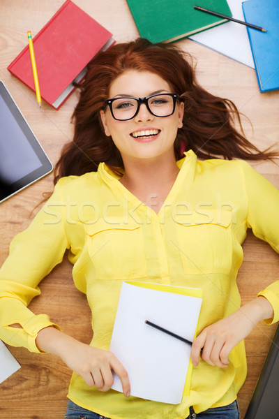 smiling female student with pencil and textbook Stock photo © dolgachov