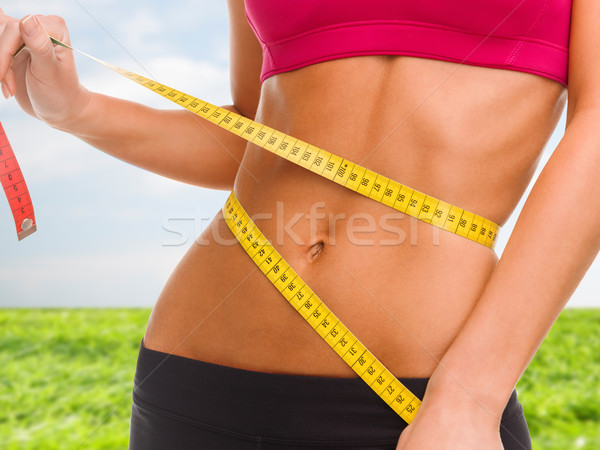 Közelkép képzett has mérőszalag sport fitnessz Stock fotó © dolgachov