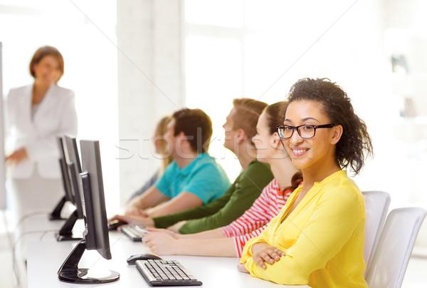 Femminile studente computer classe istruzione Foto d'archivio © dolgachov