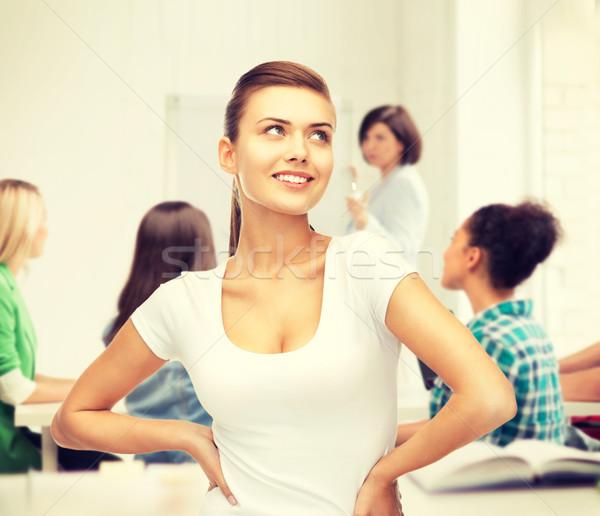 student girl in blank white t-shirt at school Stock photo © dolgachov