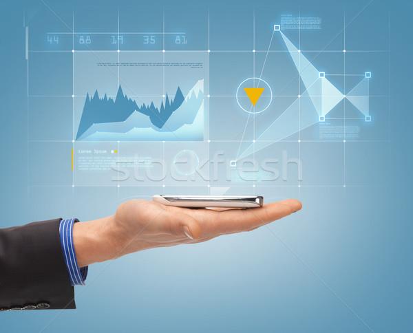 Közelkép férfi kéz okostelefon hologram jövő Stock fotó © dolgachov