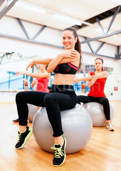 Sorridere persone pilates classe fitness Foto d'archivio © dolgachov