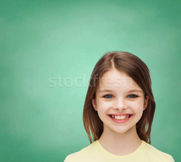 smiling little girl over white background Stock photo © dolgachov