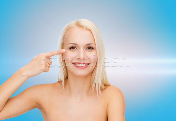 beautiful woman touching her eye area Stock photo © dolgachov