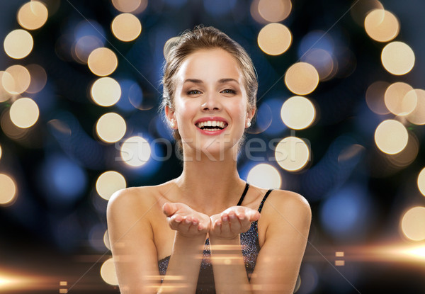 laughing woman in evening dress holding something Stock photo © dolgachov