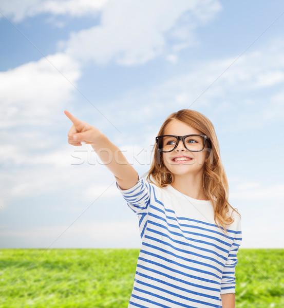 Aranyos kislány szemüveg mutat levegő oktatás Stock fotó © dolgachov