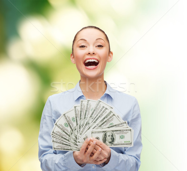 Stock photo: laughing businesswoman with dollar cash money
