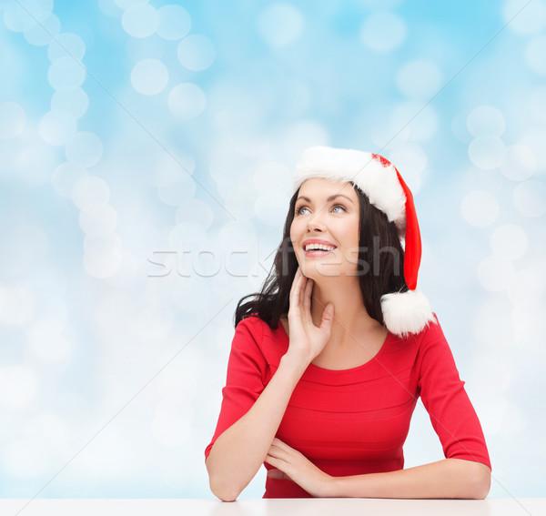 Mosolygó nő mikulás segítő kalap karácsony tél Stock fotó © dolgachov