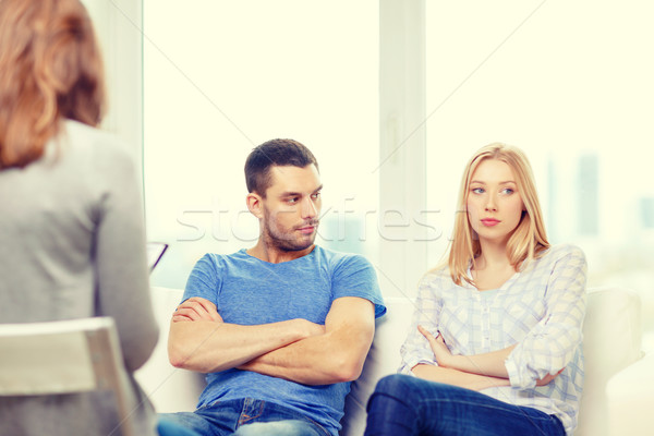 young couple with a problem at psychologist office Stock photo © dolgachov