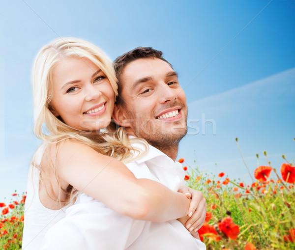 Feliz casal papoula flores campo Foto stock © dolgachov