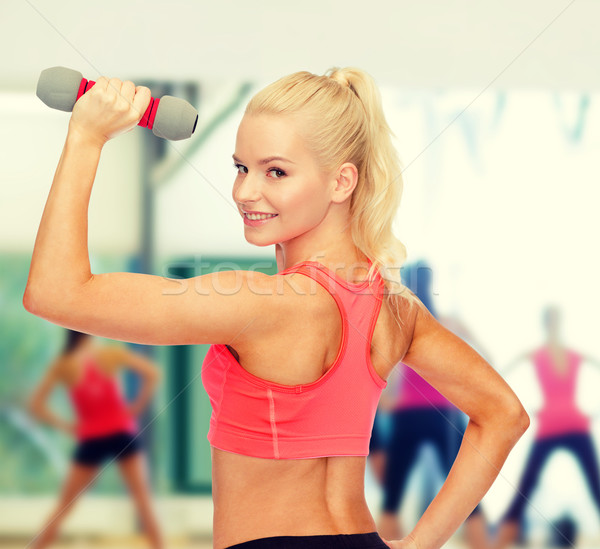 young sporty woman with light dumbbell Stock photo © dolgachov