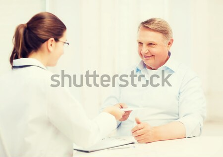 female doctor or nurse measuring blood sugar value Stock photo © dolgachov