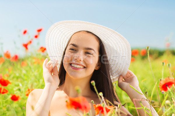 Sorridente mulher jovem chapéu de palha papoula campo felicidade Foto stock © dolgachov