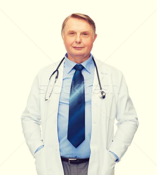 Uśmiechnięty lekarza profesor stetoskop opieki zdrowotnej muzyka Zdjęcia stock © dolgachov