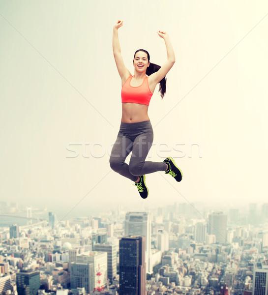 sporty teenage girl jumping in sportswear Stock photo © dolgachov