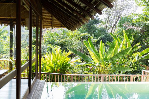 úszómedence bungaló hotel üdülőhely szabadidő utazás Stock fotó © dolgachov