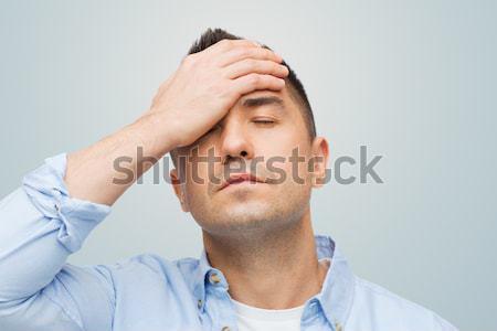 несчастный человека прикасаться лоб подчеркнуть Сток-фото © dolgachov