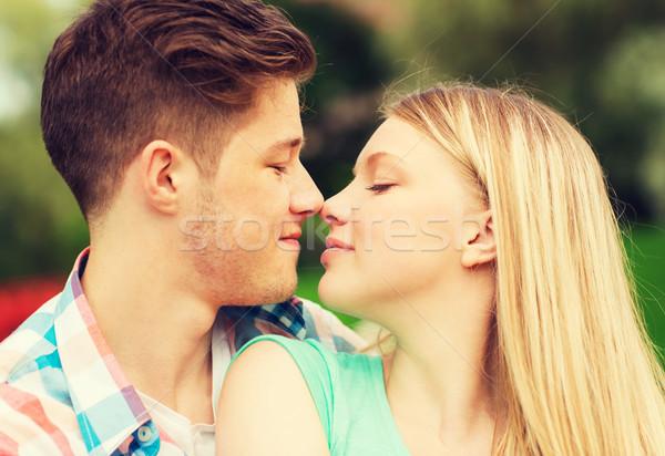 smiling couple touching noses in park Stock photo © dolgachov
