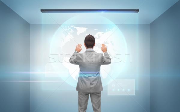 Zakenman werken hologram aarde wereldbol zakenlieden Stockfoto © dolgachov
