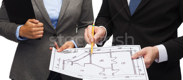 businesspeople with clipboard and blueprint Stock photo © dolgachov