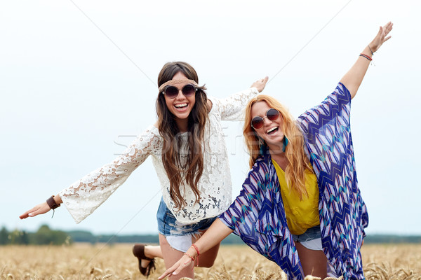 happy hippie women having fun on cereal field Stock photo © dolgachov