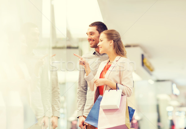 happy young couple with shopping bags in mall Stock photo © dolgachov