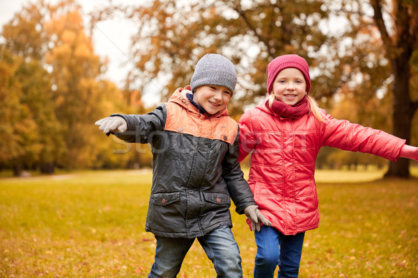 Stock photo: happy little children running and playing outdoors