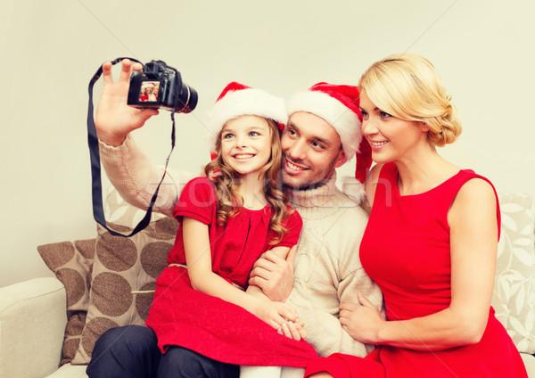 Glimlachend familie helper hoeden Stockfoto © dolgachov