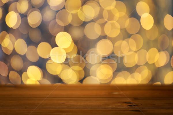 Vacío mesa de madera Navidad dorado luces vacaciones Foto stock © dolgachov