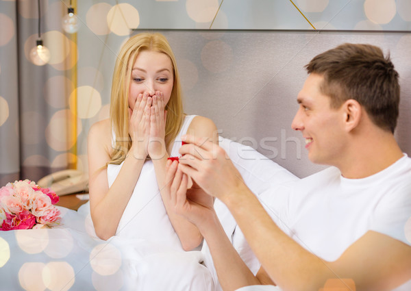 happy man giving woman diamond engagement ring Stock photo © dolgachov