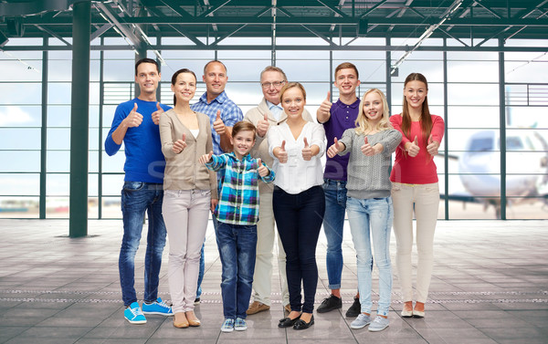 group of people showing thumbs up over airport Stock photo © dolgachov