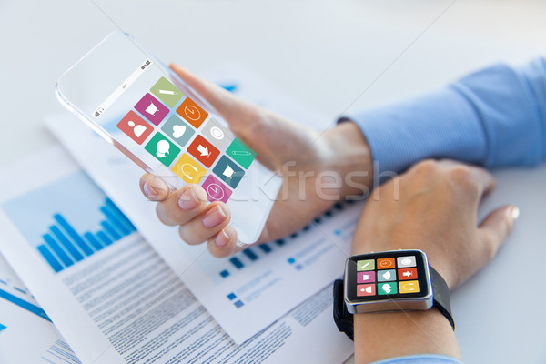close up of hands with smart phone and watch icons Stock photo © dolgachov