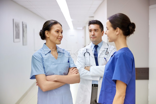 group of medics or doctors talking at hospital Stock photo © dolgachov